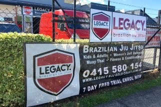 banners-stickers-wrap-business-gold coast-currumbin-fence mesh-stick it sign